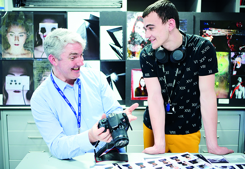 Male Student And Teacher In Photography Class At DLD College London